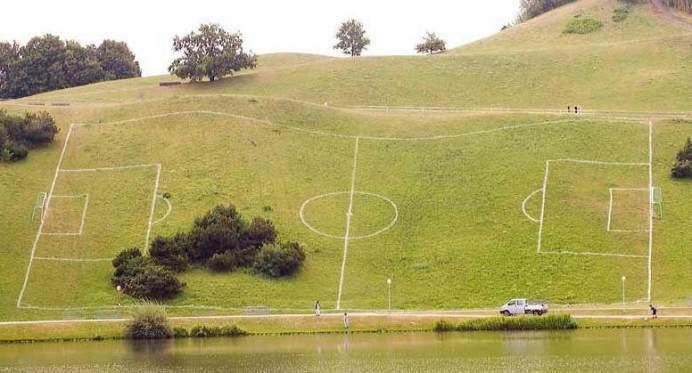 Football pitch on the side of a hill